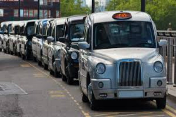 Image of a row of Taxi Cabs