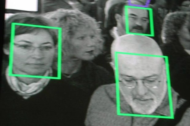 Photo of people with some faces surrounded in squares